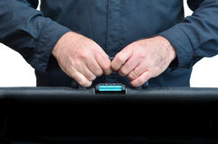 Hands of a man carry travel suitcase Stock Photos