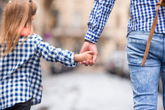 Hands of man and child holding together on street Royalty Free Stock Image