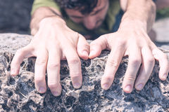 Hands of Man Climbing Stock Photo