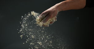 Hands of man with flour. Slow motion 4K
