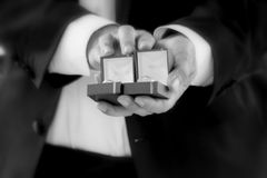 Hands of man holding open jewelry boxes stock photo