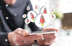 Concept of start up. Hands of man holding a smartphone with start up concept royalty free illustration