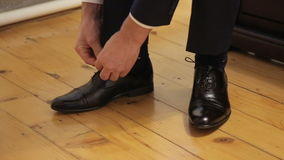 Hands of man lace shoes stock footage