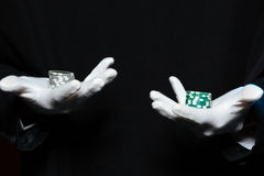 Hands of man magician in white gloves holding  casino chips Royalty Free Stock Photography