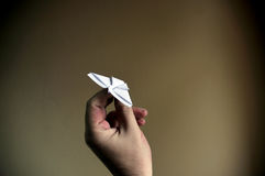 Hands of man, paper plane. Royalty Free Stock Photography