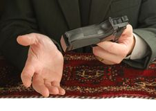 Hands of man with a pistol Royalty Free Stock Photo