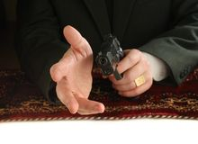 Hands of man with a pistol Stock Image