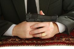 Hands of man with a pistol Royalty Free Stock Photos