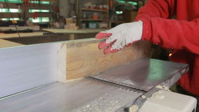 The hands of man. Planing boards marking gauge machine. stock video
