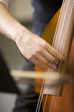 Hands of man playing the bass Royalty Free Stock Photos