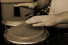 Hands of man playing the bongos Royalty Free Stock Photos