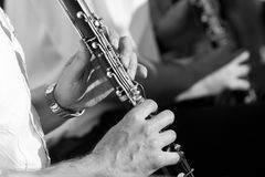 Hands of man playing the clarinet Royalty Free Stock Photos