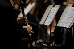 Hands of man playing the clarinet in the orchestra Stock Photos
