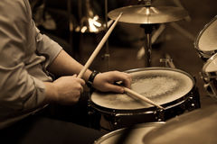 Hands of a man playing a drum set Royalty Free Stock Photos