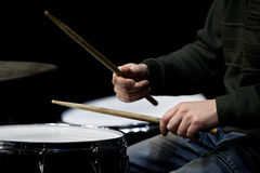 Hands of a man playing a drum set Stock Photo