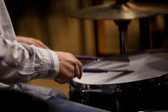 Hands of the man playing a drum set Royalty Free Stock Images