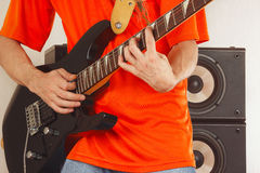 Hands of man playing the electric guitar close up Stock Photography