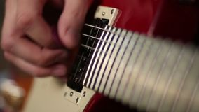 Hands of man playing electric guitar stock video
