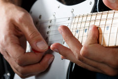 Hands of man playing electric guitar closeup Royalty Free Stock Image