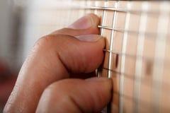 Hands of man playing electric guitar Stock Photos