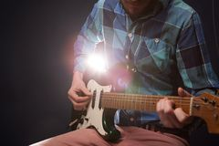 Hands of man playing electric guitar. Bend technique Stock Image