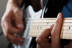 Hands of man playing electric guitar Stock Photo
