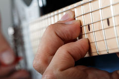 Hands of man playing electric guitar Royalty Free Stock Photos