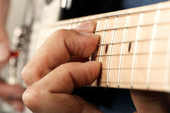 Hands of man playing electric guitar Stock Photography