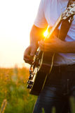 Hands of the man playing a guitar Royalty Free Stock Image