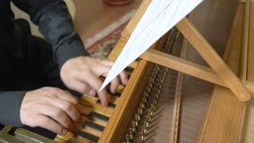 Hands of man playing harpsichord FDV stock video