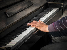 Hands of man playing an old piano Stock Image
