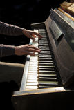 Hands of man playing an old piano Stock Photography