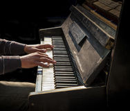 Hands of man playing an old piano Royalty Free Stock Images