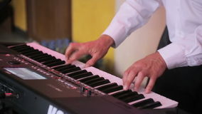 Hands of a man playing a synthesizer stock footage
