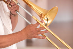 Hands of the man playing the trombone Royalty Free Stock Photo