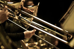 Hands of man playing the trombone Stock Photos