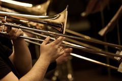 Hands of man playing the trombone Royalty Free Stock Photography
