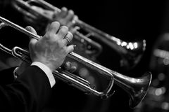 Hands of the man playing the trumpet. In black and white Stock Images