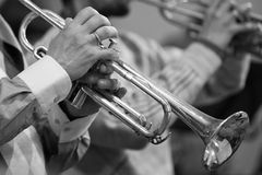 Hands of the man playing the trumpet Stock Photo