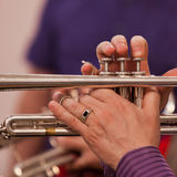 Hands of the man playing the trumpet Royalty Free Stock Photo