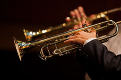 Hands of man playing the trumpet in the orchestra Royalty Free Stock Images