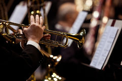 Hands of man playing the trumpet in the orchestra Stock Photos