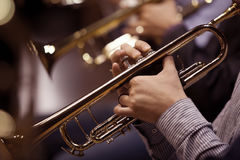 Hands of man playing the trumpet Royalty Free Stock Images