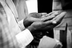 Hands of man praying in South Sudan Royalty Free Stock Images