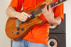 Hands of man put guitar chords Stock Photography