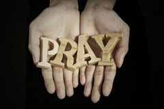 Hands of man show a word of pray Royalty Free Stock Photos