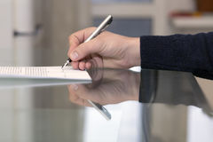 Hands of man signing formal paper Royalty Free Stock Images