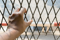 Hands of the man on a steel lattice close up Royalty Free Stock Images