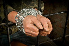 Hands of man tied up with chain Royalty Free Stock Photography