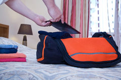Hands man and a traveling bag. Hands of a man and a traveling bag in bedroom hotel Royalty Free Stock Photography